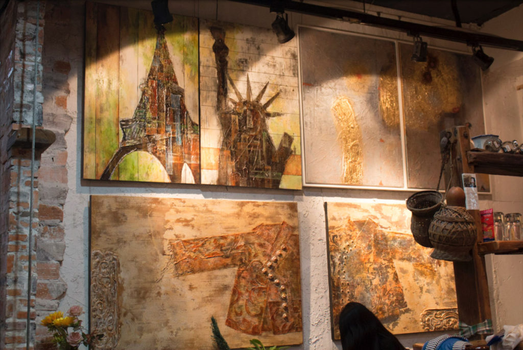 Original artwork displayed in a Dafen coffee shop.