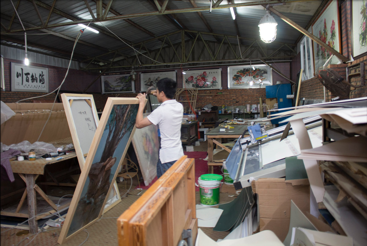 This art studio also has their own framing shop where they hand make the frames from wooden bars.