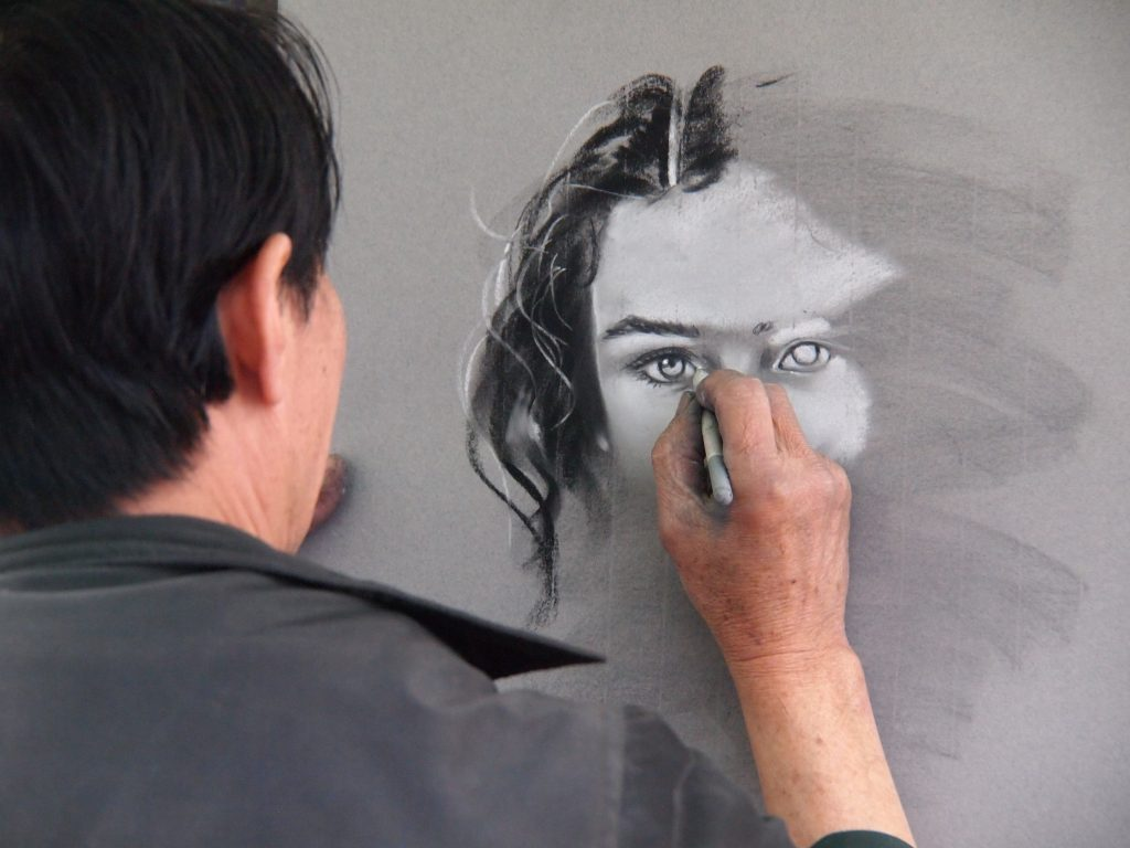 Man sketching portrait of a woman